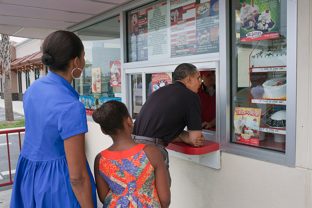 President Barack Obama, First Lady Michelle Obama, and daughter Sasha order ice cream at Bruster's in Panama City Beach, Fla., Aug. 15, 2010  (Official White House Photo by Pete Souza)