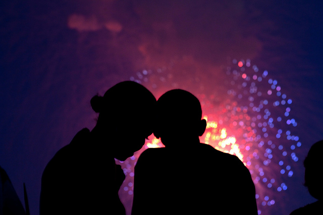 President Barack Obama and First Lady Michelle Obama watch the fireworks over the National Mall from the roof of the White House, July 4, 2010. (Official White House Photo by Pete Souza)