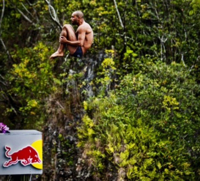 Event winner Orlando Duque (C) of Colombia, second placed Gary Hunt (L) of England and third placed Artem Silchenko (R) of Russia at Kawainui Falls during the sixth and final round of the 2010 Red Bull Cliff Diving World Series, Hilo, Hawaii on September 12; 2010. PHOTO/Dean Treml/RESTRICTED TO EDITORIAL USE