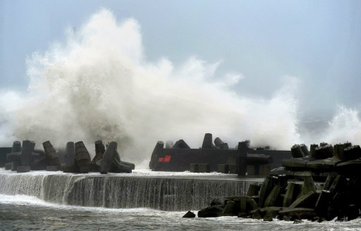 A large wave hits the coast along Nanfangauo harbour in Yilan county, eastern Taiwan, as the island braces itself for Typhoon Fanapi on September 19, 2010. Taiwan was lashed by winds of almost 200 kilometres an hour as the most powerful typhoon of the year smashed into the island, just a year after a devastating storm left hundreds dead.   AFP PHOTO / PATRICK LIN
