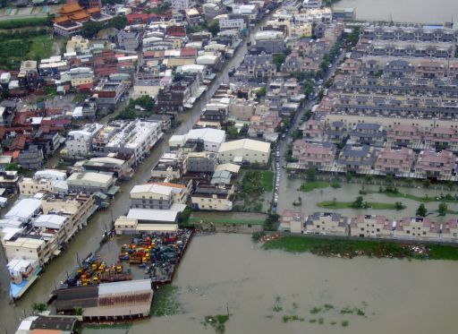 "HANDOUT RESTRICTED TO EDITORIAL USE AND EDITORIAL SALES - MANDATORY CREDIT ""AFP PHOTO / HO / AIRBORNE POLICE"" This handout aerial image taken and received on September 20, 2010 by Taiwan's Airborne Police shows areas flooded out by Typhoon Fananpi in the southern Taiwan city of Kaohsiung a day after the storm crossed the island dumping up to a metre of water of rain in some places.  Schools and offices were closed on September 20 in typhoon-hit parts of Taiwan as residents started clearing up after their homes were flooded by the storm.  AFP PHOTO / HO / AIRBORNE POLICE"