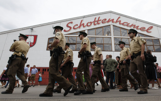Police walk past the Schottenhamel beer tent on the opening day of the 177th edition of the Oktoberfest beer festival at the Theresienwiese in Munich, southern Germany, on September 18, 2010. The world's biggest beer festival Oktoberfest, celebrating the 200th birthday since its creation, runs until October 4, 2010.   AFP PHOTO / SEBASTIAN WIDMANN