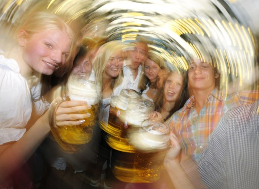 Visitors toast with beer mugs after the official opening of the 177th edition of the Oktoberfest beer festival in a tent at the Theresienwiese in Munich, southern Germany, on September 18, 2010. The world's biggest beer festival Oktoberfest, celebrating the 200th birthday since its creation, runs until October 4, 2010.   AFP PHOTO / CHRISTOF STACHE