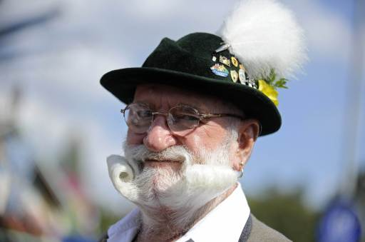 A man with a twirled beard visits the Oktoberfest beer festival at the Theresienwiese in Munich, southern Germany, September 19, 2010. The world's biggest beer festival Oktoberfest runs until October 4, 2010.     AFP PHOTO    ANDREAS GEBERT    GERMANY OUT