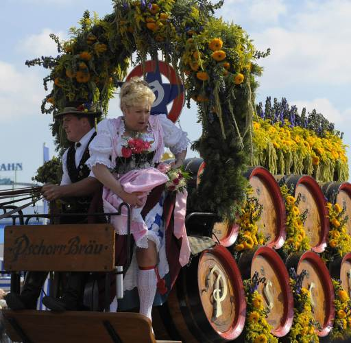 A woman sitting on a brewery's float takes part in the traditional Oktoberfest costume parade through the streets of Munich, southern Germany, September 19, 2010. The world's biggest beer festival Oktoberfest runs until October 4, 2010.     AFP PHOTO / CHRISTOF STACHE