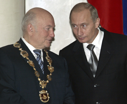 "(FILES) A file photo taken on December 17, 2003 shows then-Russian President Vladimir Putin (R) talking with Moscow's Mayor Yury Luzhkov during his investiture ceremony in Moscow after the latter was re-elected on December 7, 2003. Russian President Dmitry Medvedev on September 28, 2010 fired Luzhkov, ending a controversial 18 year rule that saw the Russian capital boom but also attracted bitter criticism. A decree, published on the Kremlin website, ordered Luzhkov, 74, to be ""dismissed from the position of Moscow mayor because he has lost the confidence of the Russian president.""    AFP PHOTO / YURI KOCHETKOV"