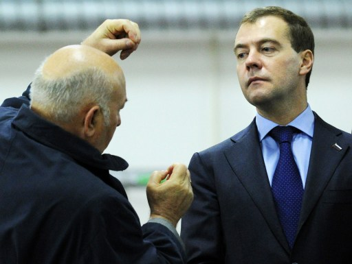 "(FILES) A file picture taken on May 27, 2010 shows Russian President Dmitry Medvedev (R) listening to Moscow Mayor Yuri Luzhkov (L) while visiting a water treatment facility outside Moscow. Medvedev on September 28, 2010 fired Luzhkov, ending a controversial 18 year rule that saw the Russian capital boom but also attracted bitter criticism. A decree, published on the Kremlin website, ordered Luzhkov, 74, to be ""dismissed from the position of Moscow mayor because he has lost the confidence of the Russian president."" AFP PHOTO / YURI KADOBNOV"