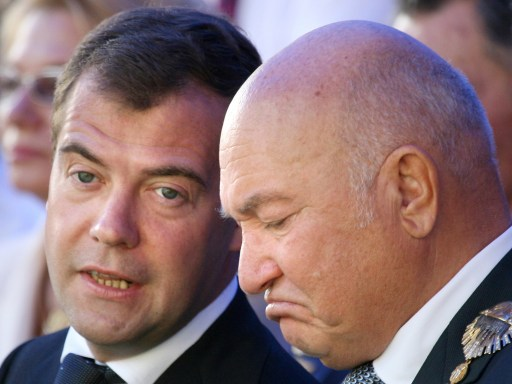 "(FILES) A file picture taken on September 7, 2008 shows Russian President Dmitry Medvedev (L) speaking with Moscow Mayor Yuri Luzhkov during the celebration of City Day in Moscow. Medvedev on September 28, 2010 fired Luzhkov, ending a controversial 18 year rule that saw the Russian capital boom but also attracted bitter criticism. A decree, published on the Kremlin website, ordered Luzhkov, 74, to be ""dismissed from the position of Moscow mayor because he has lost the confidence of the Russian president.""           AFP PHOTO / ALEXEY SAZONOV"