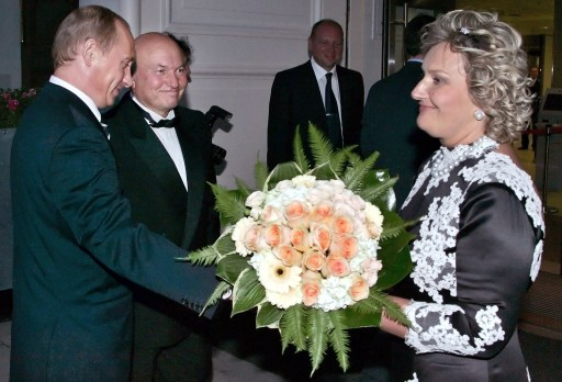 "(FILES) A picture taken on September 21, 2006 shows Russian President Vladimir Putin (L) presenting flowers to Yelena Baturina (R), the wife of  Moscow Mayor Yuri Luzhkov (C), at an event marking the latter's 70th birthday in Moscow. President Dmitry Medvedev on September 28, 2010 fired Luzhkov, ending a controversial 18 year rule that saw the Russian capital boom but also attracted bitter criticism. A decree, published on the Kremlin website, ordered Luzhkov, 74, to be ""dismissed from the position of Moscow mayor because he has lost the confidence of the Russian president."" AFP PHOTO / ITAR-TASS POOL / PRESIDENTIAL PRESS SERVICE"