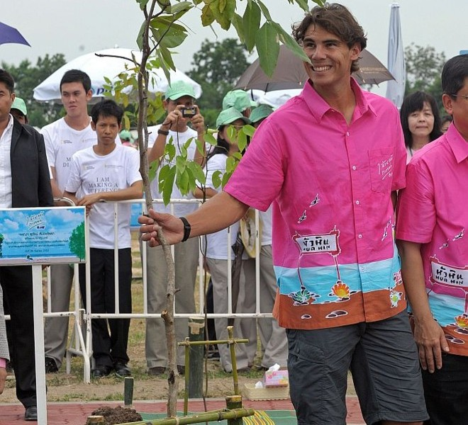 "World number one men's tennis player Rafael Nadal takes part in a tree planting project in honour of Thai King Bhumibol Adulyadej's ""One Million Trees for the King"" during a visit to the Thai city of Hua Hin on September 28, 2010. Nadal will compete in the ATP Thailand Open tennis tournament starting on September 27.    AFP PHOTO / PORNCHAI KITTIWONGSAKUL"