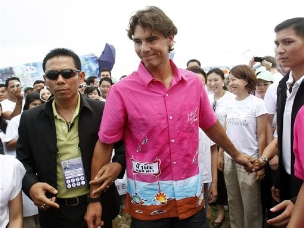 Spanish tennis player Rafael Nadal acknowledhes his fan club members after he planted a tree as part of a campaign to stop global warming and to honor Thailand's King Bhumibol at Prachuab khirikhanprovince south of Bangkok on Tuesday Sept. 28, 2010. (AP Phto/Sakchai Lalit)