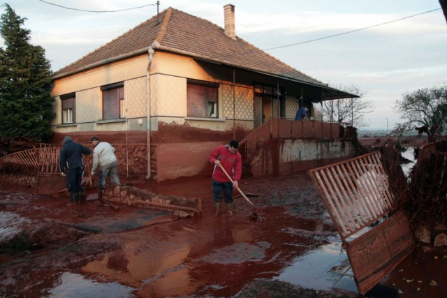 "Firemen of the Gyor town station wash a special material, industrial gypsum into the Marcal River to coagulate the toxic water at Morichida village about 150 kms west from Budapest on October 6, 2010. Several dozen family houses were flooded by the red-sludge from an alumina plant in western Hungary on Monday, flooding several towns, villages with towering waves of red sludge. Five people died, seven were missing and hundreds were injured, rescue services said. The spill of an estimated 1,000,000 cubic metres of sludge affected several localities such as Kolontar and Devecser near the Ajkai Timfoldgyar plant in the town of Ajka. AFP PHOTO / ATTILA KISBENEDEK , Firemen of the Gyor town station wash a special material, industrial gypsum, into the Marcal River to coagulate the toxic water at Morichida village about 150 kms west from Budapest on October 6, 2010. Several dozen family houses were flooded by the red-sludge from an alumina plant in western Hungary on Monday, flooding several towns, villages with towering waves of red sludge. Five people died, seven were missing and hundreds were injured, rescue services said. The spill of an estimated 1,000,000 cubic metres of sludge affected several localities such as Kolontar and Devecser near the Ajkai Timfoldgyar plant in the town of Ajka. AFP PHOTO / ATTILA KISBENEDEK , An excavator pours industrial gypsum to reduce the alkalinity into the Marcal River at the bridge of Szente about 150 kms west from Budapest on October 6, 2010. Several dozen family houses were flooded by the red-sludge from an alumina plant in western Hungary on Monday, flooding several towns, villages with towering waves of red sludge. Four people died, seven were missing and hundreds were injured, rescue services said. The spill of an estimated 1,000,000 cubic metres of sludge affected several localities such as Kolontar and Devecser near the Ajkai Timfoldgyar plant in the town of Ajka. AFP PHOTO / ATTILA KISBENEDEK , Dead fish float on the Marcal River at the bridge of Morichida about 150 kms west from Budapest on October 6, 2010. Several dozen family houses were flooded by the red-sludge from an alumina plant in western Hungary on Monday, flooding several towns, villages with towering waves of red sludge.  Four people died, seven were missing and hundreds were injured, rescue services said. The spill of an estimated 1,000,000 cubic metres of sludge affected several localities such as Kolontar and Devecser near the Ajkai Timfoldgyar plant in the town of Ajka. AFP PHOTO / ATTILA KISBENEDEK , White froth floats on the surface of the Raba River as it moves through the town of Gyor, some 130kms from Budapest on October 7, 2010. Hungary's toxic sludge spill, which has killed four people, reached the Danube river on October 7, 2010, threatening to contaminate the waterway's ecosystem, a water authority official told AFP. AFP PHOTO / ATTILA KISBENEDEK , A man walks in sludge mixed with stones in Kolontar about 160 kms southwest of  Budapest, on October 6, 2010 after a wave of toxic red mud swept through the small village two days ago, killing four and injuring scores more. The accident -- which officials say is Hungary's worst-ever chemical accident and an ""ecological disaster"" -- occurred on October 4 when the walls of a reservoir of residue at an aluminium plant in nearby Ajka broke, sending a wave of stinking red sludge through seven villages in the west of the country and leaving a trail of devastation across an area of 40 square kms (15.4 square miles). In Kolontar, the army had to build a temporary bridge to replace one that was swept away by the flood.    AFP PHOTO / ATTILA KISBENEDEK , Civil Protection Service workers clean sludge-covered streets in Kolontar about 160 kms southwest of Budapest, on October 6, 2010 after a wave of toxic red mud swept through the small village two days ago, killing four and injuring scores more. The accident -- which officials say is Hungary's worst-ever chemical accident and an ""ecological disaster"" -- occurred on October 4 when the walls of a reservoir of residue at an aluminium plant in nearby Ajka broke, sending a wave of stinking red sludge through seven villages in the west of the country and leaving a trail of devastation across an area of 40 square kms (15.4 square miles). In Kolontar, the army had to build a temporary bridge to replace one that was swept away by the flood.    AFP PHOTO / ATTILA KISBENEDEK , A man checks bedclothes and pillows in the debris of his flooded house in Kolontar about 160 kms southwest of  Budapest, on October 6, 2010 after a wave of toxic red mud swept through the small village two days ago, killing four and injuring scores more. The accident -- which officials say is Hungary's worst-ever chemical accident and an ""ecological disaster"" -- occurred on October 4 when the walls of a reservoir of residue at an aluminium plant in nearby Ajka broke, sending a wave of stinking red sludge through seven villages in the west of the country and leaving a trail of devastation across an area of 40 square kms (15.4 square miles). In Kolontar, the army had to build a temporary bridge to replace one that was swept away by the flood.    AFP PHOTO / ATTILA KISBENEDEK , A resident cleans his yard in Kolontar about 160 kms southwest of  Budapest, on October 6, 2010 after a wave of toxic red mud swept through the small village two days ago, killing four and injuring scores more. The accident -- which officials say is Hungary's worst-ever chemical accident and an ""ecological disaster"" -- occurred on October 4 when the walls of a reservoir of residue at an aluminium plant in nearby Ajka broke, sending a wave of stinking red sludge through seven villages in the west of the country and leaving a trail of devastation across an area of 40 square kms (15.4 square miles). In Kolontar, the army had to build a temporary bridge to replace one that was swept away by the flood.    AFP PHOTO / ATTILA KISBENEDEK , People remove mud from their garden in the flooded village of Kolontar, around 150kms southwest of Budapest on October 4, 2010. One person died and 60 were injured in western Hungary when a reservoir of residue from aluminium production broke and flooded two nearby villages with toxic red mud, authorities said today. AFP PHOTO / INDEX ATTILA NAGY"