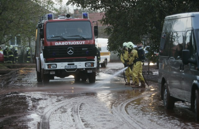"Firemen of the Gyor town station wash a special material, industrial gypsum into the Marcal River to coagulate the toxic water at Morichida village about 150 kms west from Budapest on October 6, 2010. Several dozen family houses were flooded by the red-sludge from an alumina plant in western Hungary on Monday, flooding several towns, villages with towering waves of red sludge. Five people died, seven were missing and hundreds were injured, rescue services said. The spill of an estimated 1,000,000 cubic metres of sludge affected several localities such as Kolontar and Devecser near the Ajkai Timfoldgyar plant in the town of Ajka. AFP PHOTO / ATTILA KISBENEDEK , Firemen of the Gyor town station wash a special material, industrial gypsum, into the Marcal River to coagulate the toxic water at Morichida village about 150 kms west from Budapest on October 6, 2010. Several dozen family houses were flooded by the red-sludge from an alumina plant in western Hungary on Monday, flooding several towns, villages with towering waves of red sludge. Five people died, seven were missing and hundreds were injured, rescue services said. The spill of an estimated 1,000,000 cubic metres of sludge affected several localities such as Kolontar and Devecser near the Ajkai Timfoldgyar plant in the town of Ajka. AFP PHOTO / ATTILA KISBENEDEK , An excavator pours industrial gypsum to reduce the alkalinity into the Marcal River at the bridge of Szente about 150 kms west from Budapest on October 6, 2010. Several dozen family houses were flooded by the red-sludge from an alumina plant in western Hungary on Monday, flooding several towns, villages with towering waves of red sludge. Four people died, seven were missing and hundreds were injured, rescue services said. The spill of an estimated 1,000,000 cubic metres of sludge affected several localities such as Kolontar and Devecser near the Ajkai Timfoldgyar plant in the town of Ajka. AFP PHOTO / ATTILA KISBENEDEK , Dead fish float on the Marcal River at the bridge of Morichida about 150 kms west from Budapest on October 6, 2010. Several dozen family houses were flooded by the red-sludge from an alumina plant in western Hungary on Monday, flooding several towns, villages with towering waves of red sludge.  Four people died, seven were missing and hundreds were injured, rescue services said. The spill of an estimated 1,000,000 cubic metres of sludge affected several localities such as Kolontar and Devecser near the Ajkai Timfoldgyar plant in the town of Ajka. AFP PHOTO / ATTILA KISBENEDEK , White froth floats on the surface of the Raba River as it moves through the town of Gyor, some 130kms from Budapest on October 7, 2010. Hungary's toxic sludge spill, which has killed four people, reached the Danube river on October 7, 2010, threatening to contaminate the waterway's ecosystem, a water authority official told AFP. AFP PHOTO / ATTILA KISBENEDEK , A man walks in sludge mixed with stones in Kolontar about 160 kms southwest of  Budapest, on October 6, 2010 after a wave of toxic red mud swept through the small village two days ago, killing four and injuring scores more. The accident -- which officials say is Hungary's worst-ever chemical accident and an ""ecological disaster"" -- occurred on October 4 when the walls of a reservoir of residue at an aluminium plant in nearby Ajka broke, sending a wave of stinking red sludge through seven villages in the west of the country and leaving a trail of devastation across an area of 40 square kms (15.4 square miles). In Kolontar, the army had to build a temporary bridge to replace one that was swept away by the flood.    AFP PHOTO / ATTILA KISBENEDEK , Civil Protection Service workers clean sludge-covered streets in Kolontar about 160 kms southwest of Budapest, on October 6, 2010 after a wave of toxic red mud swept through the small village two days ago, killing four and injuring scores more. The accident -- which officials say is Hungary's worst-ever chemical accident and an ""ecological disaster"" -- occurred on October 4 when the walls of a reservoir of residue at an aluminium plant in nearby Ajka broke, sending a wave of stinking red sludge through seven villages in the west of the country and leaving a trail of devastation across an area of 40 square kms (15.4 square miles). In Kolontar, the army had to build a temporary bridge to replace one that was swept away by the flood.    AFP PHOTO / ATTILA KISBENEDEK , A man checks bedclothes and pillows in the debris of his flooded house in Kolontar about 160 kms southwest of  Budapest, on October 6, 2010 after a wave of toxic red mud swept through the small village two days ago, killing four and injuring scores more. The accident -- which officials say is Hungary's worst-ever chemical accident and an ""ecological disaster"" -- occurred on October 4 when the walls of a reservoir of residue at an aluminium plant in nearby Ajka broke, sending a wave of stinking red sludge through seven villages in the west of the country and leaving a trail of devastation across an area of 40 square kms (15.4 square miles). In Kolontar, the army had to build a temporary bridge to replace one that was swept away by the flood.    AFP PHOTO / ATTILA KISBENEDEK , A resident cleans his yard in Kolontar about 160 kms southwest of  Budapest, on October 6, 2010 after a wave of toxic red mud swept through the small village two days ago, killing four and injuring scores more. The accident -- which officials say is Hungary's worst-ever chemical accident and an ""ecological disaster"" -- occurred on October 4 when the walls of a reservoir of residue at an aluminium plant in nearby Ajka broke, sending a wave of stinking red sludge through seven villages in the west of the country and leaving a trail of devastation across an area of 40 square kms (15.4 square miles). In Kolontar, the army had to build a temporary bridge to replace one that was swept away by the flood.    AFP PHOTO / ATTILA KISBENEDEK , People remove mud from their garden in the flooded village of Kolontar, around 150kms southwest of Budapest on October 4, 2010. One person died and 60 were injured in western Hungary when a reservoir of residue from aluminium production broke and flooded two nearby villages with toxic red mud, authorities said today. AFP PHOTO / INDEX ATTILA NAGY , A man check the mud on the banks of the Torna stream in the village of Kolontar, around 150kms southwest of Budapest on October 4, 2010. One person died and 60 were injured in western Hungary when a reservoir of residue from aluminium production broke and flooded two nearby villages with toxic red mud, authorities said today. AFP PHOTO / INDEX ATTILA NAGY , A crashed off-road vehicle is seen at the banks of the Torna stream in the of village of Kolontar, around 150kms southwest of Budapest on October 4, 2010. One person died and 60 were injured in western Hungary when a reservoir of residue from aluminium production broke and flooded two nearby villages with toxic red mud, authorities said today. AFP PHOTO / INDEX ATTILA NAGY , Police gives instruction to residents of Kolontar, around 150kms southwest of Budapest on October 4, 2010. One person died and 60 were injured in western Hungary when a reservoir of residue from aluminium production broke and flooded two nearby villages with toxic red mud, authorities said today. AFP PHOTO / INDEX ATTILA NAGY , People remove the mud in the flooded village of Kolontar, around 150kms southwest of Budapest on October 4, 2010. One person died and 60 were injured in western Hungary when a reservoir of residue from aluminium production broke and flooded two nearby villages with toxic red mud, authorities said today. AFP PHOTO / INDEX ATTILA NAGY , A man removes mud from his garden in the flooded village of Kolontar, around 150kms southwest of Budapest on October 4, 2010. One person died and 60 were injured in western Hungary when a reservoir of residue from aluminium production broke and flooded two nearby villages with toxic red mud, authorities said today. AFP PHOTO / INDEX ATTILA NAGY , Rescue workers clean the streets covered with mud in the village of Kolontar, around 150kms southwest of Budapest on October 4, 2010. One person died and 60 were injured in western Hungary when a reservoir of residue from aluminium production broke and flooded two nearby villages with toxic red mud, authorities said today. AFP PHOTO / JOZSEF TOTH"