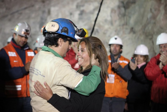 "Handout picture released by Chile's presidential press office of Chilean President Sebastian Pinera (R) smiling as Chilean miner Carlos Bugueno (L) is hugged by his mother after being brought to the surface following a 10-week ordeal in the collapsed San Jose mine, near Copiapo, 800 km north of Santiago, Chile, on October 13, 2010.  A complex rescue of the 33 miners trapped more than two months in Chile sped towards its successful finale Wednesday, with just some of the men left to be winched to a world above awed and overjoyed by their improbable salvation.    AFP PHOTO/ALEX IBANEZ/PRESIDENCIA   RESTRICTED TO EDITORIAL USE   NO SALES FOR MARKETING , Relatives of Luis Urzua (out of frame) celebrate after the last of the 33 miners was successfully rescued on October 13, 2010 following a 10-week ordeal in the collapsed San Jose mine, near Copiapo, 800 km north of Santiago, Chile. The rescue of 33 miners trapped underground in Chile was successfully completed in some 22 and a half hours. AFP PHOTO/Hector Retamal , Residents of Copiapo celebrate after the 33 miners were successfully rescued on October 13, 2010 following a 10-week ordeal in the collapsed San Jose mine, near Copiapo, 800 km north of Santiago, Chile. AFP PHOTO/ Rodrigo ARANGUA , The last of the 33 Chilean miners to be rescued, Luis Urzua (C), celebrates alongside Chilean President Sebastian Pinera (2-R) after being brought to the surface from the San Jose mine, near Copiapo, Chile on October 13, 2010. The rescue of the 33 miners trapped underground in Chile took some 22 and a half miners, with only the rescue workers left to resurface. AFP PHOTO / JUAN MABROMATA , Chilean miner Raul Bustos (L) embraces his couple as Chilean President Sebastian Pinera (R) applauds after being brought to the surface from the San Jose mine, near Copiapo, Chile on October 13, 2010. Chile. The rescue of 33 miners trapped underground in Chile could be complete ""by the end of the day,"" Mining Minister Laurence Golborne said Wednesday about halfway through the dramatic operation. AFP PHOTO/GOVERNMENT OF CHILE / Hugo Infante ------- RESTRICTED TO EDITORIAL USE / NO SALES FOR MARKETING / GETTY  OUT ------------"