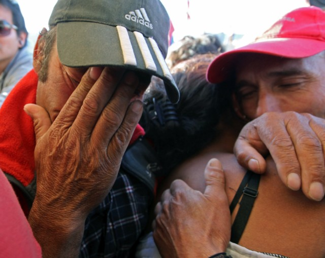 "Handout picture released by Chile's presidential press office of Chilean President Sebastian Pinera (R) smiling as Chilean miner Carlos Bugueno (L) is hugged by his mother after being brought to the surface following a 10-week ordeal in the collapsed San Jose mine, near Copiapo, 800 km north of Santiago, Chile, on October 13, 2010.  A complex rescue of the 33 miners trapped more than two months in Chile sped towards its successful finale Wednesday, with just some of the men left to be winched to a world above awed and overjoyed by their improbable salvation.    AFP PHOTO/ALEX IBANEZ/PRESIDENCIA   RESTRICTED TO EDITORIAL USE   NO SALES FOR MARKETING , Relatives of Luis Urzua (out of frame) celebrate after the last of the 33 miners was successfully rescued on October 13, 2010 following a 10-week ordeal in the collapsed San Jose mine, near Copiapo, 800 km north of Santiago, Chile. The rescue of 33 miners trapped underground in Chile was successfully completed in some 22 and a half hours. AFP PHOTO/Hector Retamal , Residents of Copiapo celebrate after the 33 miners were successfully rescued on October 13, 2010 following a 10-week ordeal in the collapsed San Jose mine, near Copiapo, 800 km north of Santiago, Chile. AFP PHOTO/ Rodrigo ARANGUA , The last of the 33 Chilean miners to be rescued, Luis Urzua (C), celebrates alongside Chilean President Sebastian Pinera (2-R) after being brought to the surface from the San Jose mine, near Copiapo, Chile on October 13, 2010. The rescue of the 33 miners trapped underground in Chile took some 22 and a half miners, with only the rescue workers left to resurface. AFP PHOTO / JUAN MABROMATA , Chilean miner Raul Bustos (L) embraces his couple as Chilean President Sebastian Pinera (R) applauds after being brought to the surface from the San Jose mine, near Copiapo, Chile on October 13, 2010. Chile. The rescue of 33 miners trapped underground in Chile could be complete ""by the end of the day,"" Mining Minister Laurence Golborne said Wednesday about halfway through the dramatic operation. AFP PHOTO/GOVERNMENT OF CHILE / Hugo Infante ------- RESTRICTED TO EDITORIAL USE / NO SALES FOR MARKETING / GETTY  OUT ------------ , Chilean President Sebastian Pinera (L) looks at a young relative of a trapped miners as they wait for the Felix 2 rescue capsule to reach the surface from the San Jose mine, near Copiapo, Chile on October 13, 2010. The rescue of 33 miners trapped underground in Chile was successfully completed in some 22 and a half hours.  AFP PHOTO/GOVERNMENT OF CHILE / Hugo Infante ------- RESTRICTED TO EDITORIAL USE / NO SALES FOR MARKETING / GETTY  OUT ------------ , Residents of Copiapo celebrate after the last of the 33 miners was successfully rescued on October 13, 2010 following a 10-week ordeal in the collapsed San Jose mine, near Copiapo, 800 km north of Santiago, Chile. The rescue of 33 miners trapped underground in Chile was successfully completed in some 22 and a half hours. AFP PHOTO/Claudio SANTANA , Residents of Copiapo celebrate after the last of the 33 miners was successfully rescued on October 13, 2010 following a 10-week ordeal in the collapsed San Jose mine, near Copiapo, 800 km north of Santiago, Chile. The rescue of 33 miners trapped underground in Chile was successfully completed in some 22 and a half hours. AFP PHOTO/Claudio SANTANA , People celebrate in Plaza Italia in Santiago after the last of the 33 miners was successfully rescued on October 13, 2010 following a 10-week ordeal in the collapsed San Jose mine, near Copiapo, 800 km north of the Chilean capital. The rescue of 33 miners trapped underground in Chile was successfully completed in some 22 and a half hours. AFP PHOTO/JORGE AMENGUAL , People celebrate in Plaza Italia in Santiago after the last of the 33 miners was successfully rescued on October 13, 2010 following a 10-week ordeal in the collapsed San Jose mine, near Copiapo, 800 km north of the Chilean capital. The rescue of 33 miners trapped underground in Chile was successfully completed in some 22 and a half hours. AFP PHOTO/JORGE AMENGUAL , Chilean miner Luis Urzua (L) greets President Sebastian Pinera (R) after reaching the surface from the San Jose mine, near Copiapo, Chile on October 13, 2010. The rescue of 33 miners trapped underground in Chile was successfully completed in some 22 and a half hours.  AFP PHOTO/GOVERNMENT OF CHILE / Hugo Infante ------- RESTRICTED TO EDITORIAL USE / NO SALES FOR MARKETING / GETTY  OUT ------------ , Bolivian miner Carlos Mamani rests in his room at Copiapo's Hospital, in Chile on October 14, 2010. Chile beamed with pride Thursday after its flawless rescue of 33 trapped miners gripped the world, while the celebrity survivors picked up their lives again in the dizzying glare of the media spotlight. AFP PHOTO/ Ariel Marinkovic , Relatives of the miners pack up their belongings a day after the miners were rescued, at San Jose mine, near Copiapo, Chile on October 14, 2010. The nightmare may be over for the families of the 33 miners rescued after their 10-week ordeal, but many are already agonizing that their loved ones could return to their dangerous work deep underground.   AFP PHOTO/ Rodrigo ARANGUA , Bolivian miner Carlos Mamani Soliz waves outside his house after being released from hospital in Copiapo, Chile on October 14, 2010.  The first three Chilean miners left hospital as they and their 30 comrades began adjusting to new lives in the media glare after 69 days trapped deep in a gold and copper mine.      AFP PHOTO / Claudio SANTANA , Bulgarian miners attend a religious mass following the rescue of 33 miners trapped underground in Chile at the Sveta Nedelia church in Sofia on October 14, 2010. The last rescuer emerged from a mine in Chile late October 13 after helping 33 miners trapped for more than two months reach the surface and cheat death in a drama watched around the world.     AFP PHOTO / NIKOLAY DOYCHINOV , Christian Rodriguez, 30 years old, his mother Najanjo and daughter Isabella follow the rescue operation of 33 miners on a large screen at the Chilean Embassy on October 13, 2010 in Washington, DC.  A complex, against-all-odds rescue of 33 miners trapped in Chile for more than two months transfixed this nation and the world, with wild celebrations breaking out at its successful completion late at night.  Approximately 250 persons met at the embassy to watch the rescue operation in San Jose.     AFP PHOTO / Stephane JOURDAIN , Chilean miner Luis Urzua (C) gestures alongside President Sebastian Pinera (R) after reaching the surface from the San Jose mine, near Copiapo, Chile on October 13, 2010. The rescue of 33 miners trapped underground in Chile was successfully completed in some 22 and a half hours.  AFP PHOTO/GOVERNMENT OF CHILE / Hugo Infante ------- RESTRICTED TO EDITORIAL USE / NO SALES FOR MARKETING / GETTY  OUT ------------ , Chilean miner Renan Avalos (C) is helped by rescue workers after being brought to the surface from the San Jose mine, near Copiapo, Chile on October 13, 2010. Chile. The rescue of 33 miners trapped underground in Chile could be complete ""by the end of the day,"" Mining Minister Laurence Golborne said Wednesday about halfway through the dramatic operation. AFP PHOTO/GOVERNMENT OF CHILE / Gabriel ORTEGA ------- RESTRICTED TO EDITORIAL USE / NO SALES FOR MARKETING / GETTY  OUT ------------ , Chilean miner Renan Avalos (C) embraces a rescue worker after being brought to the surface from the San Jose mine, near Copiapo, Chile on October 13, 2010. Chile. The rescue of 33 miners trapped underground in Chile could be complete ""by the end of the day,"" Mining Minister Laurence Golborne said Wednesday about halfway through the dramatic operation. AFP PHOTO/GOVERNMENT OF CHILE / Gabriel ORTEGA ------- RESTRICTED TO EDITORIAL USE / NO SALES FOR MARKETING / GETTY  OUT ------------ , Chilean miner Franklin Lobos, a fomer soccer player, holds a football as hi is taken on a trolley to the field hospital for a primary checkup after being brought to surface from the San Jose mine, near Copiapo, Chile, on October 13, 2010. The rescue of 33 miners trapped underground in Chile could be complete ""by the end of the day,"" Mining Minister Laurence Golborne said Wednesday about halfway through the dramatic operation.  AFP PHOTO/GOVERNMENT OF CHILE / Gabriel ABRIEL ORTEGA     RESTRICTED TO EDITORIAL USE   NO SALES FOR MARKETING , Chilean miner Franklin Lobos, a former soccer player, holds a football after being brought to the surface from the San Jose mine, near Copiapo, Chile on October 13, 2010. Chile. The rescue of 33 miners trapped underground in Chile could be complete ""by the end of the day,"" Mining Minister Laurence Golborne said Wednesday about halfway through the dramatic operation. AFP PHOTO/GOVERNMENT OF CHILE / Gabriel ORTEGA     RESTRICTED TO EDITORIAL USE   NO SALES FOR MARKETING , Relatives of miner Renan Avalos celebrate after he was rescued from the San Jose mine, in Copiapo, Chile, on October 13, 2010. The rescue of 33 miners trapped underground in Chile could be complete ""by the end of the day,"" Mining Minister Laurence Golborne said Wednesday about halfway through the dramatic operation. AFP PHOTO/Hector RETAMAL , Relatives of Dario Segovia celebrate after he was brought to the surface from the San Jose mine, near Copiapo, Chile on October 13, 2010. Chile. The rescue of 33 miners trapped underground in Chile could be complete ""by the end of the day,"" Mining Minister Laurence Golborne said Wednesday about halfway through the dramatic operation.  TOPSHOTS/AFP PHOTO/Hector Retamal , Relatives of Renan Avalos react after he was brought to surface from the San Jose mine, near Copiapo, Chile, on October 13, 2010. A complex rescue of the 33 miners trapped more than two months in Chile sped towards its successful finale Wednesday, with just some of the men left to be winched to a world above awed and overjoyed by their improbable salvation.  AFP PHOTO/ Hector Retamal"