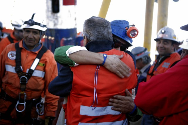 "Handout picture released by Chile's presidential press office of Chilean President Sebastian Pinera (R) smiling as Chilean miner Carlos Bugueno (L) is hugged by his mother after being brought to the surface following a 10-week ordeal in the collapsed San Jose mine, near Copiapo, 800 km north of Santiago, Chile, on October 13, 2010.  A complex rescue of the 33 miners trapped more than two months in Chile sped towards its successful finale Wednesday, with just some of the men left to be winched to a world above awed and overjoyed by their improbable salvation.    AFP PHOTO/ALEX IBANEZ/PRESIDENCIA   RESTRICTED TO EDITORIAL USE   NO SALES FOR MARKETING , Relatives of Luis Urzua (out of frame) celebrate after the last of the 33 miners was successfully rescued on October 13, 2010 following a 10-week ordeal in the collapsed San Jose mine, near Copiapo, 800 km north of Santiago, Chile. The rescue of 33 miners trapped underground in Chile was successfully completed in some 22 and a half hours. AFP PHOTO/Hector Retamal , Residents of Copiapo celebrate after the 33 miners were successfully rescued on October 13, 2010 following a 10-week ordeal in the collapsed San Jose mine, near Copiapo, 800 km north of Santiago, Chile. AFP PHOTO/ Rodrigo ARANGUA , The last of the 33 Chilean miners to be rescued, Luis Urzua (C), celebrates alongside Chilean President Sebastian Pinera (2-R) after being brought to the surface from the San Jose mine, near Copiapo, Chile on October 13, 2010. The rescue of the 33 miners trapped underground in Chile took some 22 and a half miners, with only the rescue workers left to resurface. AFP PHOTO / JUAN MABROMATA , Chilean miner Raul Bustos (L) embraces his couple as Chilean President Sebastian Pinera (R) applauds after being brought to the surface from the San Jose mine, near Copiapo, Chile on October 13, 2010. Chile. The rescue of 33 miners trapped underground in Chile could be complete ""by the end of the day,"" Mining Minister Laurence Golborne said Wednesday about halfway through the dramatic operation. AFP PHOTO/GOVERNMENT OF CHILE / Hugo Infante ------- RESTRICTED TO EDITORIAL USE / NO SALES FOR MARKETING / GETTY  OUT ------------ , Chilean President Sebastian Pinera (L) looks at a young relative of a trapped miners as they wait for the Felix 2 rescue capsule to reach the surface from the San Jose mine, near Copiapo, Chile on October 13, 2010. The rescue of 33 miners trapped underground in Chile was successfully completed in some 22 and a half hours.  AFP PHOTO/GOVERNMENT OF CHILE / Hugo Infante ------- RESTRICTED TO EDITORIAL USE / NO SALES FOR MARKETING / GETTY  OUT ------------ , Residents of Copiapo celebrate after the last of the 33 miners was successfully rescued on October 13, 2010 following a 10-week ordeal in the collapsed San Jose mine, near Copiapo, 800 km north of Santiago, Chile. The rescue of 33 miners trapped underground in Chile was successfully completed in some 22 and a half hours. AFP PHOTO/Claudio SANTANA , Residents of Copiapo celebrate after the last of the 33 miners was successfully rescued on October 13, 2010 following a 10-week ordeal in the collapsed San Jose mine, near Copiapo, 800 km north of Santiago, Chile. The rescue of 33 miners trapped underground in Chile was successfully completed in some 22 and a half hours. AFP PHOTO/Claudio SANTANA , People celebrate in Plaza Italia in Santiago after the last of the 33 miners was successfully rescued on October 13, 2010 following a 10-week ordeal in the collapsed San Jose mine, near Copiapo, 800 km north of the Chilean capital. The rescue of 33 miners trapped underground in Chile was successfully completed in some 22 and a half hours. AFP PHOTO/JORGE AMENGUAL , People celebrate in Plaza Italia in Santiago after the last of the 33 miners was successfully rescued on October 13, 2010 following a 10-week ordeal in the collapsed San Jose mine, near Copiapo, 800 km north of the Chilean capital. The rescue of 33 miners trapped underground in Chile was successfully completed in some 22 and a half hours. AFP PHOTO/JORGE AMENGUAL , Chilean miner Luis Urzua (L) greets President Sebastian Pinera (R) after reaching the surface from the San Jose mine, near Copiapo, Chile on October 13, 2010. The rescue of 33 miners trapped underground in Chile was successfully completed in some 22 and a half hours.  AFP PHOTO/GOVERNMENT OF CHILE / Hugo Infante ------- RESTRICTED TO EDITORIAL USE / NO SALES FOR MARKETING / GETTY  OUT ------------ , Bolivian miner Carlos Mamani rests in his room at Copiapo's Hospital, in Chile on October 14, 2010. Chile beamed with pride Thursday after its flawless rescue of 33 trapped miners gripped the world, while the celebrity survivors picked up their lives again in the dizzying glare of the media spotlight. AFP PHOTO/ Ariel Marinkovic , Relatives of the miners pack up their belongings a day after the miners were rescued, at San Jose mine, near Copiapo, Chile on October 14, 2010. The nightmare may be over for the families of the 33 miners rescued after their 10-week ordeal, but many are already agonizing that their loved ones could return to their dangerous work deep underground.   AFP PHOTO/ Rodrigo ARANGUA , Bolivian miner Carlos Mamani Soliz waves outside his house after being released from hospital in Copiapo, Chile on October 14, 2010.  The first three Chilean miners left hospital as they and their 30 comrades began adjusting to new lives in the media glare after 69 days trapped deep in a gold and copper mine.      AFP PHOTO / Claudio SANTANA , Bulgarian miners attend a religious mass following the rescue of 33 miners trapped underground in Chile at the Sveta Nedelia church in Sofia on October 14, 2010. The last rescuer emerged from a mine in Chile late October 13 after helping 33 miners trapped for more than two months reach the surface and cheat death in a drama watched around the world.     AFP PHOTO / NIKOLAY DOYCHINOV , Christian Rodriguez, 30 years old, his mother Najanjo and daughter Isabella follow the rescue operation of 33 miners on a large screen at the Chilean Embassy on October 13, 2010 in Washington, DC.  A complex, against-all-odds rescue of 33 miners trapped in Chile for more than two months transfixed this nation and the world, with wild celebrations breaking out at its successful completion late at night.  Approximately 250 persons met at the embassy to watch the rescue operation in San Jose.     AFP PHOTO / Stephane JOURDAIN , Chilean miner Luis Urzua (C) gestures alongside President Sebastian Pinera (R) after reaching the surface from the San Jose mine, near Copiapo, Chile on October 13, 2010. The rescue of 33 miners trapped underground in Chile was successfully completed in some 22 and a half hours.  AFP PHOTO/GOVERNMENT OF CHILE / Hugo Infante ------- RESTRICTED TO EDITORIAL USE / NO SALES FOR MARKETING / GETTY  OUT ------------ , Chilean miner Renan Avalos (C) is helped by rescue workers after being brought to the surface from the San Jose mine, near Copiapo, Chile on October 13, 2010. Chile. The rescue of 33 miners trapped underground in Chile could be complete ""by the end of the day,"" Mining Minister Laurence Golborne said Wednesday about halfway through the dramatic operation. AFP PHOTO/GOVERNMENT OF CHILE / Gabriel ORTEGA ------- RESTRICTED TO EDITORIAL USE / NO SALES FOR MARKETING / GETTY  OUT ------------ , Chilean miner Renan Avalos (C) embraces a rescue worker after being brought to the surface from the San Jose mine, near Copiapo, Chile on October 13, 2010. Chile. The rescue of 33 miners trapped underground in Chile could be complete ""by the end of the day,"" Mining Minister Laurence Golborne said Wednesday about halfway through the dramatic operation. AFP PHOTO/GOVERNMENT OF CHILE / Gabriel ORTEGA ------- RESTRICTED TO EDITORIAL USE / NO SALES FOR MARKETING / GETTY  OUT ------------"