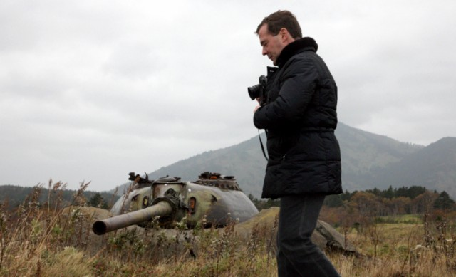 Russian President Dmitry Medvedev walks near a Soviet-era fortifications during his visit to Kunashir one of the Kuril islands on November 1, 2010. Medvedev stoked Japan's ire on Monday with a visit to the Kuril islands, a remote territory at the heart of a decades-long dispute with Tokyo. Japan summoned Russia's ambassador to Tokyo after Medvedev flew into the island of Kunashir, on the first visit by a Russian leader to the isles which have prevented a post-World War II peace treaty between the two neighbours. AFP PHOTO/ RIA-NOVOSTI/ KREMLIN POOL/  MIKHAIL KLIMENTYEV