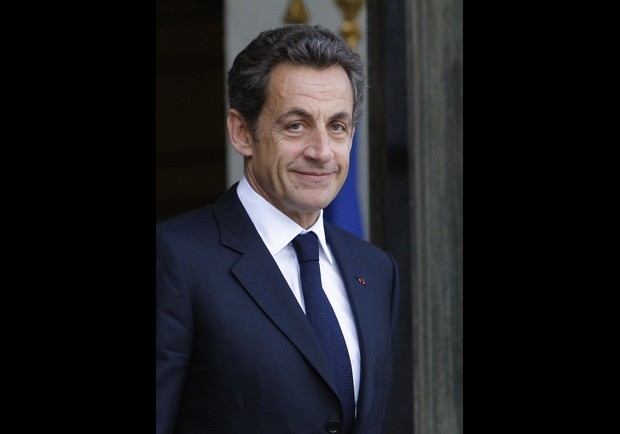 France's President Nicolas Sarkozy waits for Chile President Sebastian Pinera at the Elysee Palace, Paris, Wednesday, Oct. 20, 2010. (AP Photo/Jacques Brinon)