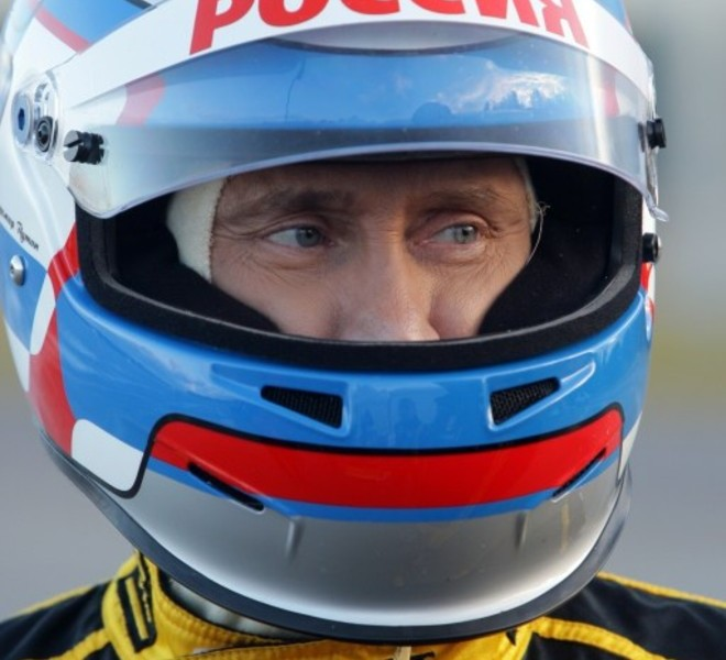 Russian Prime Minister Vladimir Putin wears the uniform of the Renault Formula One team before driving a F1 race car on a special track in Leningrad region outside St. Petersburg on November 7, 2010.  AFP PHOTO / RIA NOVOSTI / POOL / ALEXEY DRUZHININ
