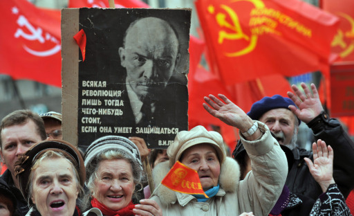Activists of the Communist party wave during a rally on Independence Square in Kiev on November 7, 2010. Several thousand supporters of Communist ideals marched to mark the overthrowing of the Romanov Dynasty by Bolshevik forces. AFP PHOTO/ SERGEI SUPINSKY