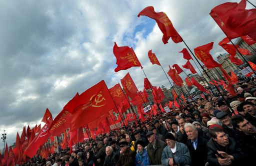 "Supporters of Communist ideaology rallied on November 7, 2010 in Kiev to mark Bolshevik Revolution Day, refered to as the ""Great October Socialist Revolution Day"" in the central of Ukrainian capital. AFP PHOTO/ SERGEI SUPINSKY"