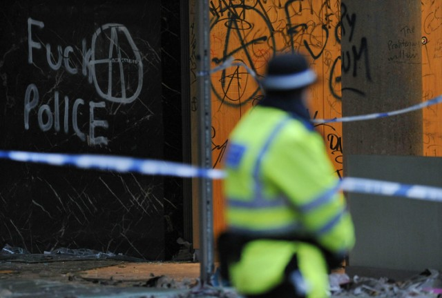 "A police officer guards the damaged entrance to 30 Millbank, a building housing the headquarters of the British Conservative Party, in London, on November 11, 2010. British Prime Minister David Cameron condemned as ""completely unacceptable"" Thursday the actions of students who stormed his party's London headquarters in protest over plans to increase tuition fees. Fourteen people were injured and about 35 arrested after thousands of demonstrators besieged the 1960s office building near parliament, smashing their way through the glass frontage and wrecking the lobby. AFP PHOTO/CARL COURT , A British police community support officer stands guard besides damage and graffiti left by protestors at 30 Millbank, a building housing the headquarters of the British Conservative Party, in London, on November 11, 2010. British Prime Minister David Cameron condemned as ""completely unacceptable"" Thursday the actions of students who stormed his party's London headquarters in protest over plans to increase tuition fees. Fourteen people were injured and about 35 arrested after thousands of demonstrators besieged the 1960s office building near parliament, smashing their way through the glass frontage and wrecking the lobby. AFP PHOTO/CARL COURT , A British police community support officer stands guard besides graffiti left by protestors on the walls of 30 Millbank, a building housing the headquarters of the British Conservative Party, in London, on November 11, 2010. British Prime Minister David Cameron condemned as ""completely unacceptable"" Thursday the actions of students who stormed his party's London headquarters in protest over plans to increase tuition fees. Fourteen people were injured and about 35 arrested after thousands of demonstrators besieged the 1960s office building near parliament, smashing their way through the glass frontage and wrecking the lobby. AFP PHOTO/CARL COURT"