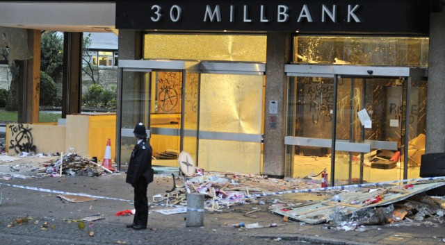 "A police officer guards the damaged entrance to 30 Millbank, a building housing the headquarters of the British Conservative Party, in London, on November 11, 2010. British Prime Minister David Cameron condemned as ""completely unacceptable"" Thursday the actions of students who stormed his party's London headquarters in protest over plans to increase tuition fees. Fourteen people were injured and about 35 arrested after thousands of demonstrators besieged the 1960s office building near parliament, smashing their way through the glass frontage and wrecking the lobby. AFP PHOTO/CARL COURT , A British police community support officer stands guard besides damage and graffiti left by protestors at 30 Millbank, a building housing the headquarters of the British Conservative Party, in London, on November 11, 2010. British Prime Minister David Cameron condemned as ""completely unacceptable"" Thursday the actions of students who stormed his party's London headquarters in protest over plans to increase tuition fees. Fourteen people were injured and about 35 arrested after thousands of demonstrators besieged the 1960s office building near parliament, smashing their way through the glass frontage and wrecking the lobby. AFP PHOTO/CARL COURT , A British police community support officer stands guard besides graffiti left by protestors on the walls of 30 Millbank, a building housing the headquarters of the British Conservative Party, in London, on November 11, 2010. British Prime Minister David Cameron condemned as ""completely unacceptable"" Thursday the actions of students who stormed his party's London headquarters in protest over plans to increase tuition fees. Fourteen people were injured and about 35 arrested after thousands of demonstrators besieged the 1960s office building near parliament, smashing their way through the glass frontage and wrecking the lobby. AFP PHOTO/CARL COURT , A man cleans graffiti off a wall of Millbank Tower next to 30 Millbank, a building housing the headquarters of the British Conservative Party, in London, on November 11, 2010. British Prime Minister David Cameron condemned as ""completely unacceptable"" Thursday the actions of students who stormed his party's London headquarters in protest over plans to increase tuition fees. Fourteen people were injured and about 35 arrested after thousands of demonstrators besieged the 1960s office building near parliament, smashing their way through the glass frontage and wrecking the lobby. AFP PHOTO/CARL COURT , The damaged entrance to 30 Millbank, a building housing the headquarters of the British Conservative Party, is pictured in London, on November 11, 2010. British Prime Minister David Cameron condemned as ""completely unacceptable"" Thursday the actions of students who stormed his party's London headquarters in protest over plans to increase tuition fees. Fourteen people were injured and about 35 arrested after thousands of demonstrators besieged the 1960s office building near parliament, smashing their way through the glass frontage and wrecking the lobby. AFP PHOTO/CARL COURT , A cleaner clears debris from the forecourt of the damaged entrance to 30 Millbank, a building housing the headquarters of the British Conservative Party, in London, on November 11, 2010. British Prime Minister David Cameron condemned as ""completely unacceptable"" Thursday the actions of students who stormed his party's London headquarters in protest over plans to increase tuition fees. Fourteen people were injured and about 35 arrested after thousands of demonstrators besieged the 1960s office building near parliament, smashing their way through the glass frontage and wrecking the lobby. AFP PHOTO/CARL COURT , A police officer inspects the damage caused by protestors to the outside of 30 Millbank, a building housing the headquarters of the British Conservative Party, in London, on November 11, 2010. British Prime Minister David Cameron condemned as ""completely unacceptable"" Thursday the actions of students who stormed his party's London headquarters in protest over plans to increase tuition fees. AFP PHOTO/CARL COURT"