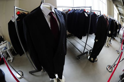 Suits which belonged to disgraced financier Bernie Madoff, are displayed during a press preview of items from Madoff to be auctioned, at the Brooklyn Navy Yard, November 10, 2010 in New York. Hundreds of items once belonging to Madoff will be auctioned off on November 13, 2010, running the gamut from a massive emerald-cut diamond to his black bedroom slippers, US officials said. AFP PHOTO/Emmanuel Dunand