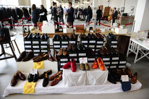 Shoes which belonged to disgraced financier Bernie Madoff, are displayed during a press preview of items from Madoff to be auctioned, at the Brooklyn Navy Yard, November 10, 2010. Hundreds of items once belonging to Madoff will be auctioned off on November 13, 2010, running the gamut from a massive emerald-cut diamond to his black bedroom slippers, US officials said. Proceeds from the auction will compensate the victims of his multibillion USD Ponzi scheme. TOPSHOTS/AFP PHOTO/Emmanuel Dunand