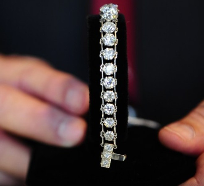 (FILES) Dated November 10, 2010 filed photo shows jewelry which belonged to disgraced financier Bernie Madoff, are displayed during a press preview of items from Madoff to be auctioned, at the Brooklyn Navy Yard, in New York.  Imprisoned Wall Street conman Bernard Madoff's luxury watches, piano and other ill-gotten gains sold for high prices at auction November 13, 2010, along with his more mundane possessions including socks.  A Steinway grand piano went for 42,000 dollars in the New York auction of goods seized by the US Marshall's Service after Madoff's life imprisonment last year.  The former money man's craze for wrist watches was apparently shared at the auction, where proceeds will go toward compensating victims of the decades-long pyramid, or Ponzi fraud.  A Rolex moonphase watch sold for 67,500 dollars, while a Rolex Cosmograph Daytona fetched 40,000 dollars and two vintage Patek Philippe watches went for 56,000 and 37,500 dollars.  Other items among the mountain of luxury goods impounded from Madoff's Manhattan and Long Island homes -- which have already been auctioned off, along with boats and other Wall Street trophies -- were jewels, furniture and artwork.     AFP PHOTO / Emmanuel Dunand / FILES