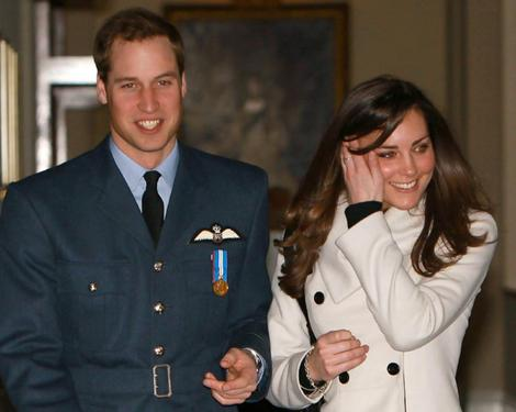 Britain's Prince William smiles as he walks with his girlfriend Kate Middleton at RAF Cranwell, central England.