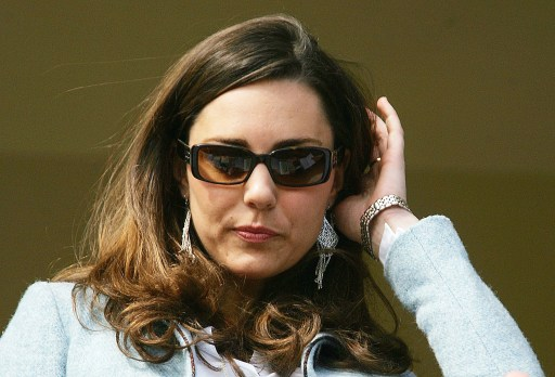 (FILES) A file photo taken March 16, 2007, shows Kate Middleton, girlfriend of Britain's Prince William, standing in the Royal Box, on the Gold Cup day of the annual Cheltenham Race Festival, at Cheltenham Race course in Gloucestershire, west of England. Britain's Prince William, the second in line to the throne, will marry his long-term girlfriend Kate Middleton next year, Clarence House said Tuesday, November 16, 2010.  William, 28, the eldest son of heir to the throne Prince Charles and the late Princess Diana, and Middleton, also 28, became engaged in October while on holiday in Kenya, it said in a statement.     AFP PHOTO/CARL DE SOUZA/FILES