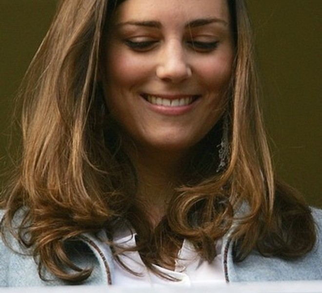 Britain Prince William's girlfriend Kate Middleton smiles as she stands in the royal box on the Gold Cup day of the annual Cheltenham Race Festival at Cheltenham Race course, in Gloucestershire, west of England, 16 March 2007. AFP PHOTO/CARL DE SOUZA. (Photo credit should read CARL DE SOUZA/AFP/Getty Images)