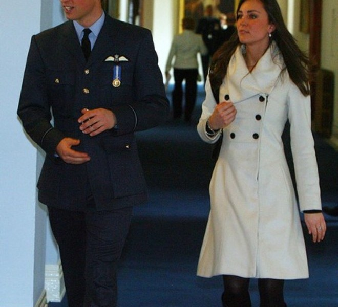 Britain's Prince William (L) and his girlfriend Kate Middleton are pictured after his graduation ceremony at RAF Cranwell air base in Lincolnshire, on April 11, 2008. Britain's Prince William graduated as a Royal Air Force (RAF) pilot on Friday after successfully completing an intensive flying course.The prince, 25, received his wings from his father Prince Charles in a graduation ceremony at the RAF Cranwell air base in Lincolnshire, east central England. AFP PHOTO/PAUL ELLIS/POOL (Photo credit should read PAUL ELLIS/AFP/Getty Images)
