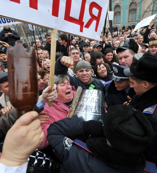 Protesters clash with police during a rally in front of Ukraine's parliament in Kiev on November 16, 2010. Ukrainian small and medium-sized enterprise owners protested against tax reform debating by the parliament. AFP PHOTO/ SERGEI SUPINSKY