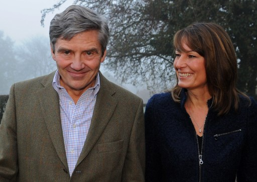 Michael and Carole Middleton, the parents of Britain's Prince William's fianc?e Kate, pose for a photograph at their home in Berkshire, southern England on November 16, 2010.  Britain's Prince William will marry long-term girlfriend Kate Middleton next year, ending feverish speculation about when the second-in-line to the throne would wed, the royal family announced Tuesday.  William, the eldest son of heir to the throne Prince Charles and the late Princess Diana, and Middleton, the daughter of a wealthy businessman, got engaged in October while on holiday in Kenya, said Clarence House, Charles' official residence.              AFP PHOTO / STEFAN ROUSSEAU / POOL