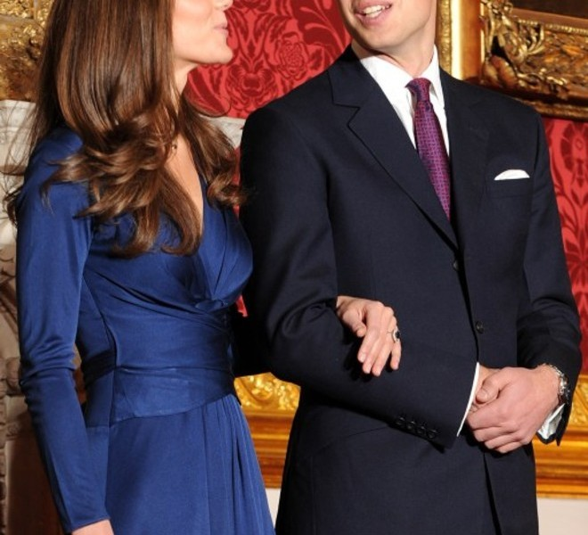 Britain's Prince William (R) and his fianc?e Kate Middleton pose for photographers during a photocall to mark their engagement, in the State Rooms of St James?s Palace, central London, on November 16, 2010. Prince William will marry his girlfriend Kate Middleton next year, the royal family said Tuesday, in the biggest royal wedding in Britain since his parents Charles and Diana married in 1981.  The announcement ended feverish speculation about when the second-in-line to the throne would wed, after a romance that has already lasted nearly eight years.  AFP PHOTO/BEN STANSALL