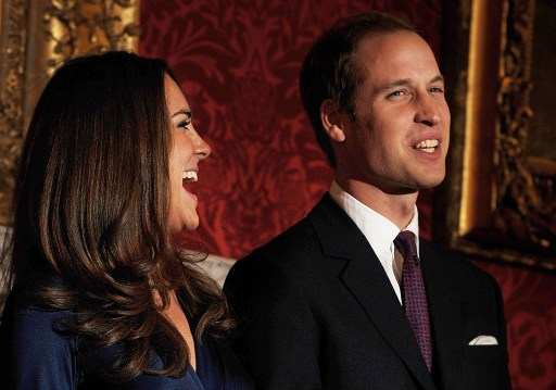 Britain's Prince William and his fianc?e Kate Middleton react as they pose for photographers during a photocall to mark their engagement, in the State Rooms of St James?s Palace, central London on November 16, 2010.  Britain's Prince William has given his fiancee Kate Middleton the engagement ring that belonged to his late mother Diana, Princess of Wales, Clarence House said Tuesday.  The blue sapphire and diamond ring was given to Diana by William's father, Prince Charles, when they became engaged in February 1981. Charles and Diana divorced in 1996 and she was killed in a car crash in Paris the following year.      AFP PHOTO / BEN STANSALL