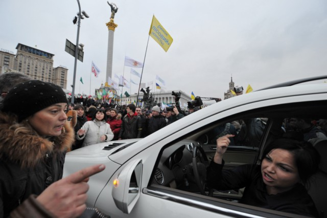 People hold their passports as they put their signatures to hold a national referendum for dissolution of Ukrainian parliament, during a rally in front of President Viktor Yanukovych's office in Kiev, on November 22, 2010. In recent months, small and medium sized business owners have repeatedly criticized the government's plan to unify several laws into a tax code due to enter into force on January 1. AFP PHOTO/ SERGEI SUPINSKY , Policemen stnad guard in front of President Viktor Yanukovych's office during rally gathering thousands of small business owners to protest against tax reforms, on November 22, 2010 in Kiev. The protest was one of the largest yet in a series of demonstrations against the tax reform, which was passed last week by the parliament and is due to come into force on January 1.    AFP PHOTO/ SERGEI SUPINSKY , Policemen stnad guard in front of President Viktor Yanukovych's office during rally gathering thousands of small business owners to protest against tax reforms, on November 22, 2010 in Kiev. The protest was one of the largest yet in a series of demonstrations against the tax reform, which was passed last week by the parliament and is due to come into force on January 1.    AFP PHOTO/ SERGEI SUPINSKY , A wreath has been set on a police fence as policemen stnad guard in front of President Viktor Yanukovych's office during rally gathering thousands of small business owners to protest against tax reforms, on November 22, 2010 in Kiev. The protest was one of the largest yet in a series of demonstrations against the tax reform, which was passed last week by the parliament and is due to come into force on January 1.    AFP PHOTO/ SERGEI SUPINSKY , People demonstrate in front of President Viktor Yanukovych's office during rally gathering thousands of small business owners to protest against tax reforms, on November 22, 2010 in Kiev. The protest was one of the largest yet in a series of demonstrations against the tax reform, which was passed last week by the parliament and is due to come into force on January 1.    AFP PHOTO/ SERGEI SUPINSKY , Protesters argue with a driver as they blocked the road on Independence Square during a rally gathering thousands of small business owners to protest against tax reforms, on November 22, 2010 in Kiev. The protest was one of the largest yet in a series of demonstrations against the tax reform, which was passed last week by the parliament and is due to come into force on January 1.    AFP PHOTO/ SERGEI SUPINSKY