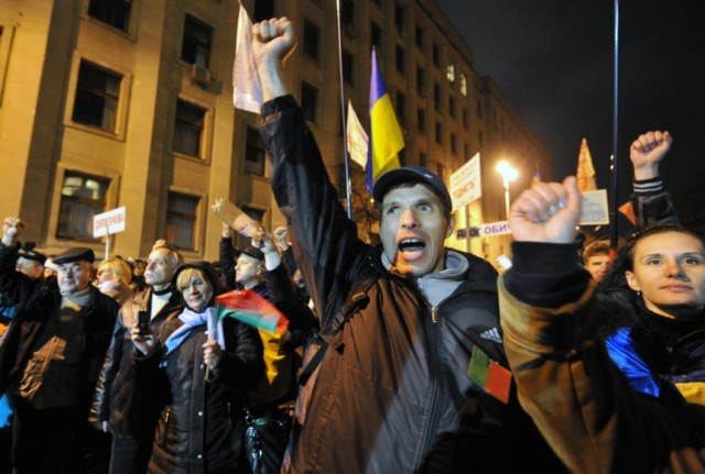 People hold their passports as they put their signatures to hold a national referendum for dissolution of Ukrainian parliament, during a rally in front of President Viktor Yanukovych's office in Kiev, on November 22, 2010. In recent months, small and medium sized business owners have repeatedly criticized the government's plan to unify several laws into a tax code due to enter into force on January 1. AFP PHOTO/ SERGEI SUPINSKY , Policemen stnad guard in front of President Viktor Yanukovych's office during rally gathering thousands of small business owners to protest against tax reforms, on November 22, 2010 in Kiev. The protest was one of the largest yet in a series of demonstrations against the tax reform, which was passed last week by the parliament and is due to come into force on January 1.    AFP PHOTO/ SERGEI SUPINSKY , Policemen stnad guard in front of President Viktor Yanukovych's office during rally gathering thousands of small business owners to protest against tax reforms, on November 22, 2010 in Kiev. The protest was one of the largest yet in a series of demonstrations against the tax reform, which was passed last week by the parliament and is due to come into force on January 1.    AFP PHOTO/ SERGEI SUPINSKY , A wreath has been set on a police fence as policemen stnad guard in front of President Viktor Yanukovych's office during rally gathering thousands of small business owners to protest against tax reforms, on November 22, 2010 in Kiev. The protest was one of the largest yet in a series of demonstrations against the tax reform, which was passed last week by the parliament and is due to come into force on January 1.    AFP PHOTO/ SERGEI SUPINSKY , People demonstrate in front of President Viktor Yanukovych's office during rally gathering thousands of small business owners to protest against tax reforms, on November 22, 2010 in Kiev. The protest was one of the largest yet in a series of demonstrations against the tax reform, which was passed last week by the parliament and is due to come into force on January 1.    AFP PHOTO/ SERGEI SUPINSKY