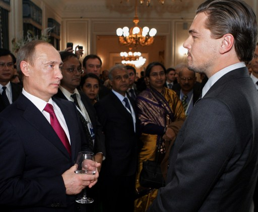 Russian Prime Minister Vladimir Putin (L) speaks with US actor Leonardo DiCaprio on November 23, 2010 at a concert to mark the International Tiger Conservation Forum at the Mikhailovsky theater in Saint Petersburg. The summit received a high-profile boost earlier when it emerged that DiCaprio pledged one million US dollars to save tigers. AFP PHOTO / RIA-NOVOSTI POOL/  ALEXEY DRUZHININ
