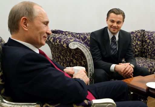 Russian Prime Minister Vladimir Putin (L) speaks with US actor Leonardo DiCaprio on November 23, 2010 after a concert to mark the International Tiger Conservation Forum at the Mikhailovsky theater in Saint Petersburg. The summit received a high-profile boost earlier when it emerged that DiCaprio pledged one million US dollars to save tigers. AFP PHOTO / RIA-NOVOSTI POOL/  ALEXEY DRUZHININ