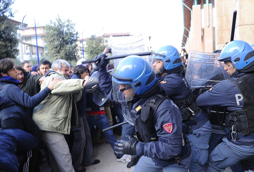 Students of Florence University scuffle with Italian police forces on November 25, 2010 during their protest against proposed reforms. Students from several cities protested against the government's proposed reform of the university system and budget cuts that Prime Minister Silvio Berlusconi's government has engaged to carry out by 2013. Students are outraged over cuts of around nine billion euros (12 billion US dollars) and 130,000 jobs in the education system.  AFP PHOTO / FABIO MUZZI