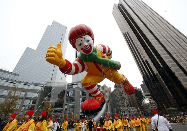 The Ronald McDonald balloon floats through Columbus Circle during the 84th Macy's Thanksgiving day parade in New York November 25, 2010.  REUTERS/Brendan McDermid (UNITED STATES - Tags: SOCIETY)