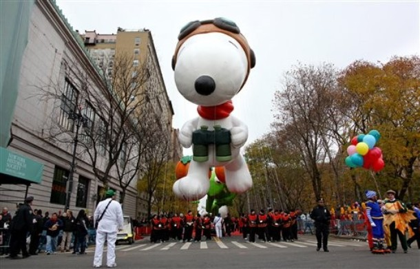 The balloon Snoopy floats above the street before the start of the Macy's Thanksgiving Day Parade in New York Thursday, Nov. 25, 2010.  (AP Photo/Craig Ruttle)