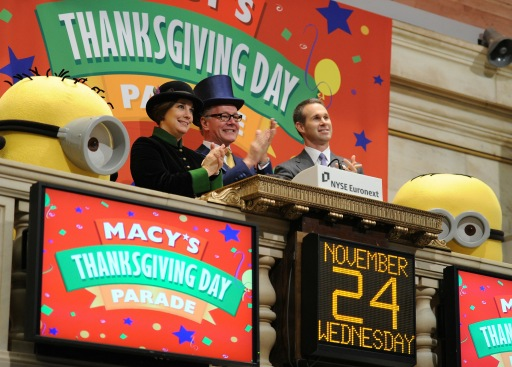 NEW YORK - NOVEMBER 24: Macy's Thanksgiving Day Parade executive producer Amy Kule, former executive producer Robin Hall, NYSE, Global Corporate Client Group Senior Vice President Scott Cutler, and minions from 'Despicable Me' celebrate the 84th Thanksgiving Day Parade at New York Stock Exchange on November 24, 2010 in New York, New York.   Stephen Lovekin/Getty Images/AFP== FOR NEWSPAPERS, INTERNET, TELCOS & TELEVISION USE ONLY ==