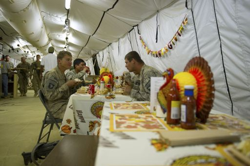 "US soldiers of the 502nd Infantry regiment 2nd Batallion enjoy a Thanksgiving lunch in the camp of Howz-e-Madad district near Kandahar city on November 25, 2010. The Pentagon admitted November 23 in a report that progress has been ""uneven"" in the war in Afghanistan, with only modest gains against the Taliban insurgency despite a surge of US and NATO troops.  AFP PHOTO / MARTIN BUREAU"