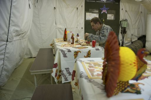 "A US soldier of the 502nd Infantry regiment 2nd Batallion enjoys a Thanksgiving lunch in the camp of Howz-e-Madad district near Kandahar city on November 25, 2010. The Pentagon admitted November 23 in a report that progress has been ""uneven"" in the war in Afghanistan, with only modest gains against the Taliban insurgency despite a surge of US and NATO troops.  AFP PHOTO / MARTIN BUREAU"