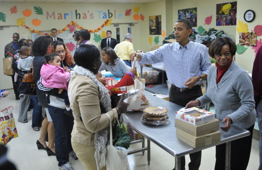 US President Barack Obama and his mother-in-law Marian Robinson (R) distribute food at Martha?s Table a day before Thanksgiving, on November 24, 2010 in Washington, DC. Martha's Table is a non-profit organization that provides food, shelter and clothing to those in need. AFP PHOTO/Mandel NGAN
