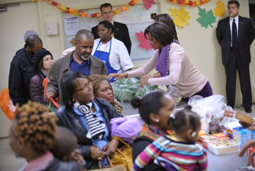 First Lady Michelle Obama distribute food at Martha?s Table a day before Thanksgiving, on November 24, 2010 in Washington, DC. Martha's Table is a non-profit organization that provides food, shelter and clothing to those in need. AFP PHOTO/Mandel NGAN
